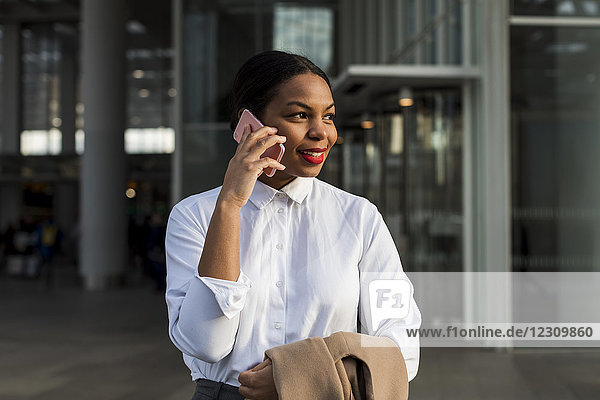 UK  London  portrait of smiling businesswoman on the phone