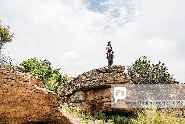 Young female tourist looking out from rock at Bourkes Potholes  Mpumalanga  South Africa