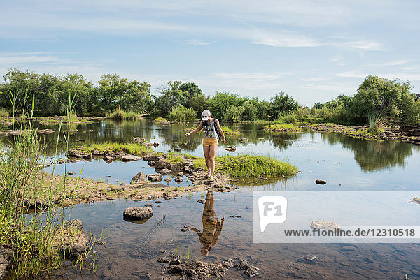 Young female tourist exploring calm waters near Victoria Falls  Zimbabwe  Africa