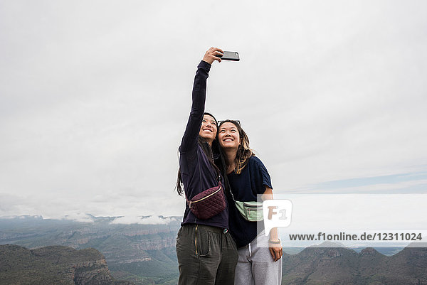 Two young female tourists taking selfie from The Three Rondavels  Mpumalanga  South Africa