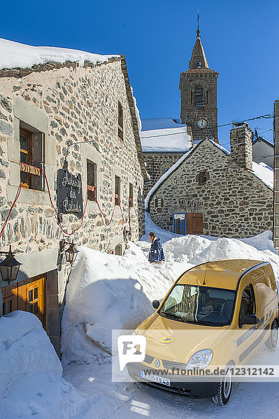 France  Auvergne-Rhones-Alpes  Haute-Loire  Les Estables  the sleigh from the old days has been replaced by mini-vans  but the postman still does his delivery rounds  no matter how high the snow is