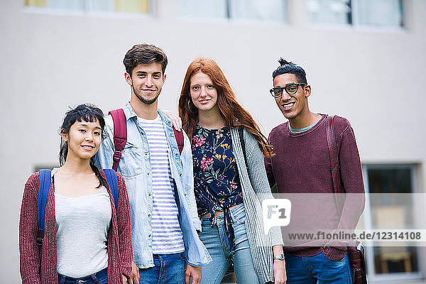 College students standing together outdoors  portrait
