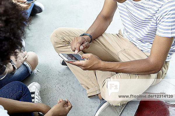 Students hanging out using smart phone