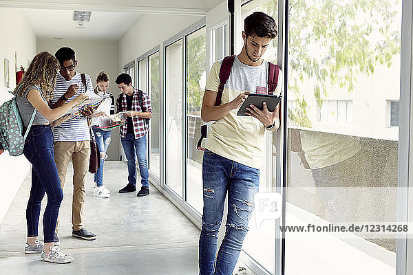 Students hanging out in school corridor