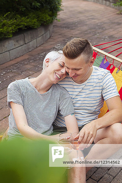 Couple drinking white wine in garden