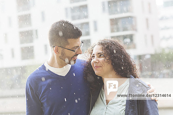 Portrait of mid adult couple standing in rain