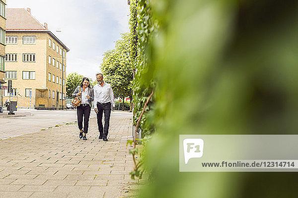 Senior man and woman walking on city street Senior man and woman walking on city street