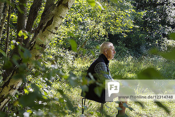 Man sitting in forest