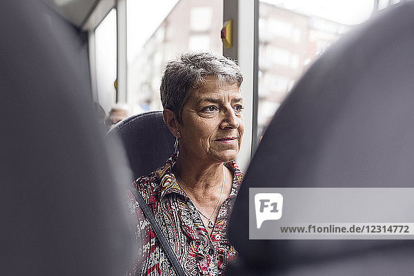 Woman looking through bus window