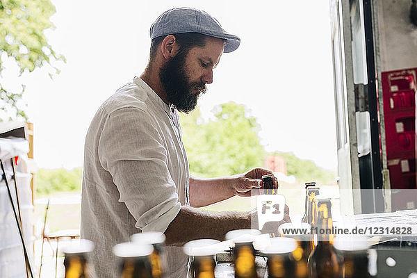 Brewery worker preparing beer bottles Brewery worker preparing beer bottles