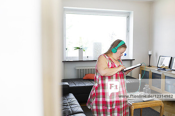 Woman with down syndrome using digital tablet Woman with down syndrome using digital tablet