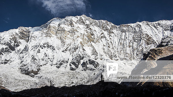 The silhouette of a photographer in front of Annapurna  Himalayas  Nepal  Asia