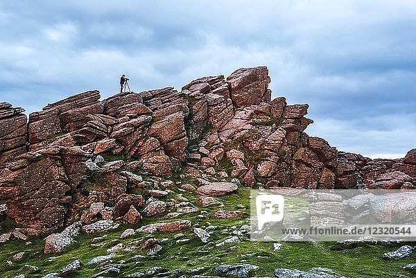 Photographer on a Tor in Dartmoor National Park  Devon  England  United Kingdom  Europe