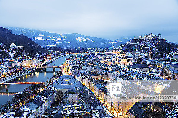View over the old town  UNESCO World Heritage Site  and Hohensalzburg Castle at dusk  Salzburg  Austria  Europe