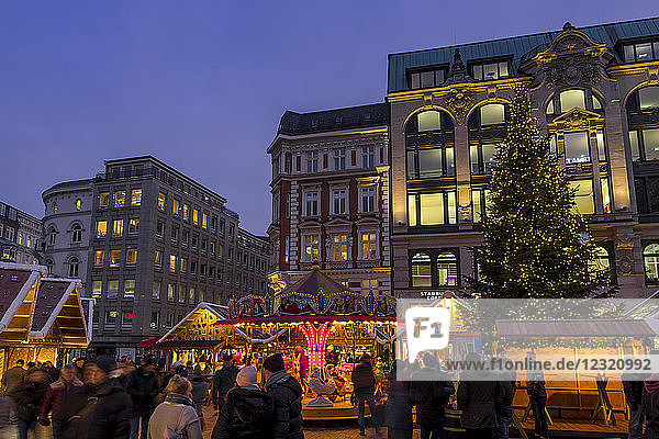 Christmas market at Gaensemarkt square at dusk  Hamburg  Germany  Europe