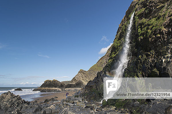 Waterfall cascading over a sea cliff at Tresaith  Ceredigion  West Wales  United Kingdom  Europe