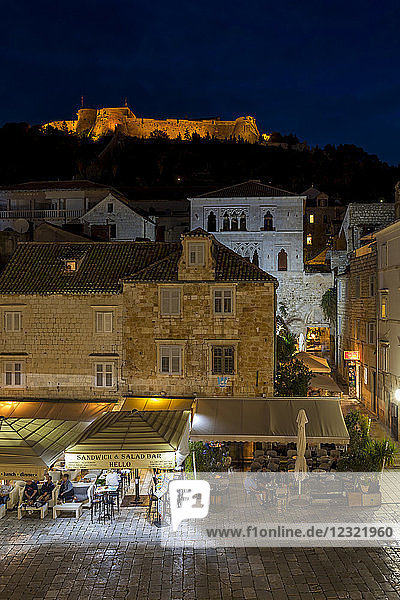 Elevated view over Svetog Stjepana square and the Spanish Fortress at night  Hvar  Croatia  Europe