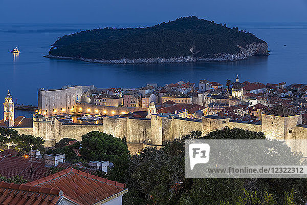 Elevated view from a lookout over the old town of Dubrovnik and Lokrum Island at dusk  Dubrovnik  Croatia  Europe