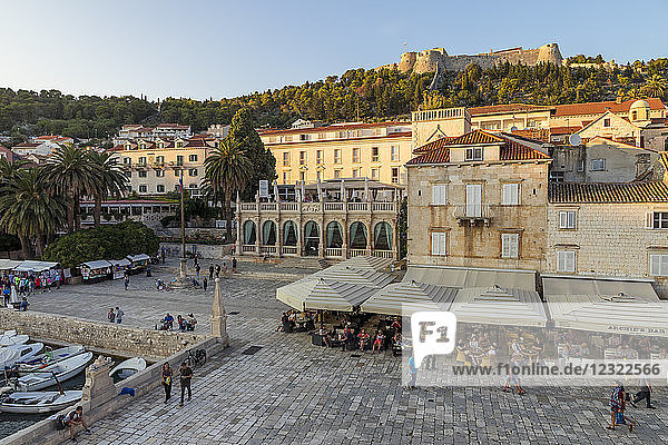 Elevated view over the main square (Trg Svetog Stjepana) and the Spanish Fortress in Hvar Town at first sunlight  Hvar  Croatia  Europe