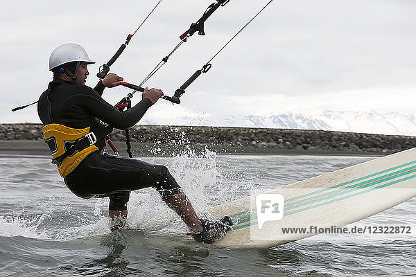 Man kitesurfing in Kachemak Bay  South-central Alaska; Alaska  United States of America
