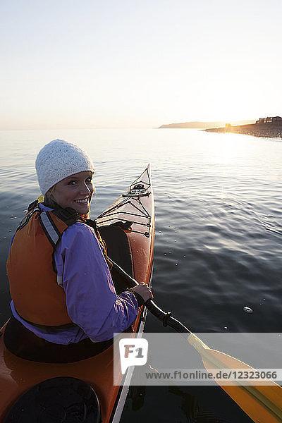 Young woman sea kayaking in Kachemak Bay  near Homer  South-central Alaska; Alaska  United States of America