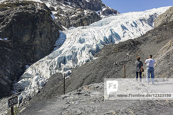 Tourist photographs receding Exit Glacier in Kenai Fjords National Park near Seward; Alaska  United States of America