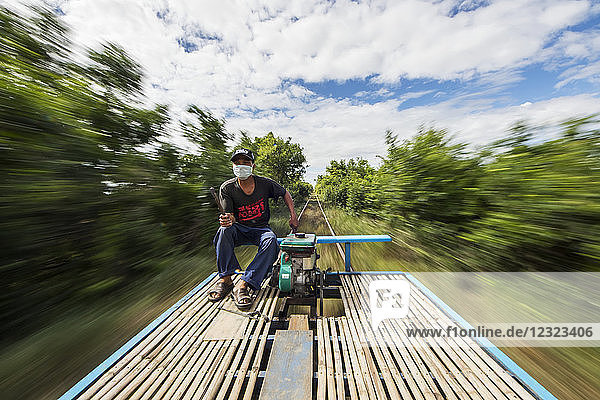 Driver on the Norry  the bamboo train; Battambang  Cambodia
