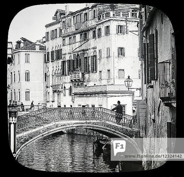 Magic lantern slide circa 1900.Victorian/Edwardian.Social History. The Beauties of Venice photographs created in 1888 Joseph John William ACWORTH F.I.C.  F.C.S.J. The Beauties of Venice . may be made by land across the canals by bridges and along their narrow banks by the narrow streets. . This is one of the larger canals  and the houses or palaces are inhabited by some of the well-to-do of the city. On our left we notice a high post standing straight up out of the water. These posts-for there are many in front of each palace-are painted with the heraldic colours of the family  and were formerly the distinguishing marks of the nobility [B] They are used as moorings for their own and also for their visitors' gondolas.