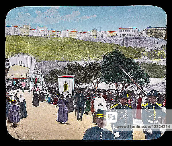 Magic Lantern slide circa 1900. Victorian or Edwardian era. The origional monchrome ( black and white ) photograph hand coloured.The photograph is the work of G.W. Wilson photographer and slide manufacturer 1823-1893.George Washington Wilson (7 February 1823 – 9 March 1893) was a pioneering Scottish photographer. The French Riviera and Monte Carlo (lecture ) . Slide 48  ST Devote's procession La Condamine. The 26 January every year the Principality of Monaco celebrates their patron St. Devote where they burn a boat on the harbour  not far from the valley of Gaumates and the district of La Condamine. The next day  January 27 (day of the feast of Saint Devote)  hosts an impressive procession.
