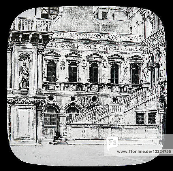 Magic lantern slide circa 1900.Victorian/Edwardian.Social History. The Beauties of Venice photographs created in 1888 Joseph John William ACWORTH F.I.C.  F.C.S.J. The Beauties of Venice . Giant's Staircase  Side View. This gives us a nearer view of a portion of our last picture. There is a side view of the Giant's Staircase and statues at the top. On our left is a statue of Duke Francis Maria I. of Urbino. The other statue  in the niche  is antique  and one of a number of such ornaments around its courtyard. Much of the work here seen was executed at the time when Venice was at the culminating point of her glory  when she was the focus of the entire commerce of Europe  numbered 200 000 inhabitants  and was universally respected and admired [B]