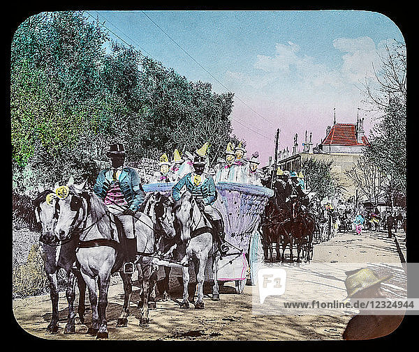 Magic Lantern slide circa 1900. Victorian or Edwardian era. The origional monchrome ( black and white ) photograph hand coloured.The photograph is the work of G.W. Wilson photographer and slide manufacturer 1823-1893.George Washington Wilson (7 February 1823 – 9 March 1893) was a pioneering Scottish photographer. The French Riviera and Monte Carlo (lecture ) . Slide 18 Carnival Procession Grasse France