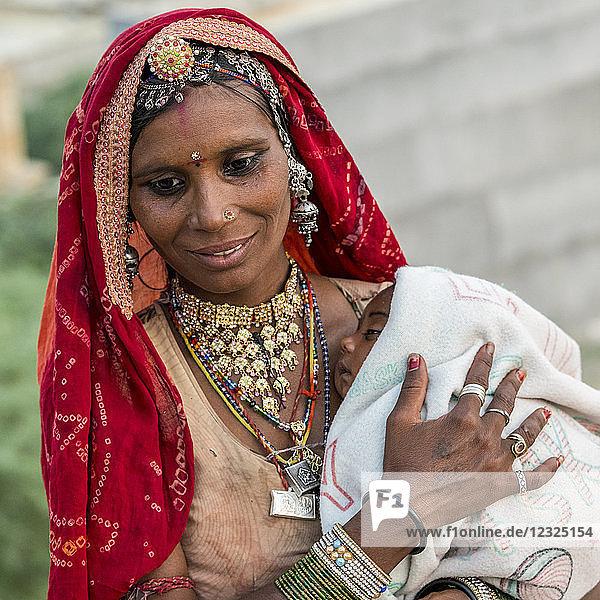 A mother holding her sleepy baby; Jaisalmer  Rajasthan  India