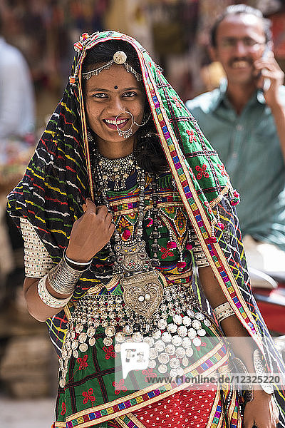 Portrait of a Hindu Indian woman in colourful traditional clothing and accessories  Jaisalmer Fort; Jaisalmer  Rajasthan  India