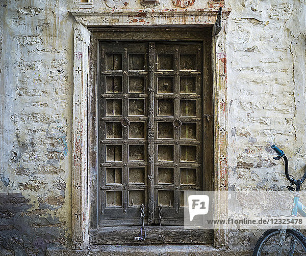 A weathered wooden door  Jaisalmer Fort  one of the largest fully preserved fortified cities in the world; Jaisalmer  Rajasthan  India