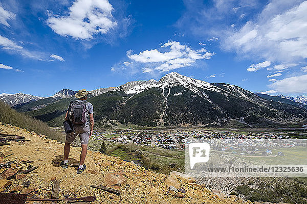 A senior man hiking with a view of Kendall Mountain in the distance; Silverton  Colorado  United States of America