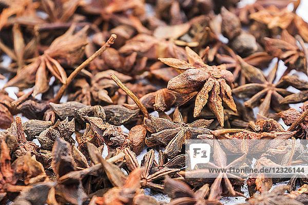 Star anis (Illicium verum) for sale at the Sunday market; Bac Ha  Lao Cai  Vietnam