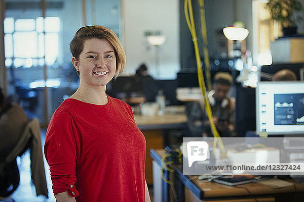 Portrait smiling  confident creative businesswoman in office