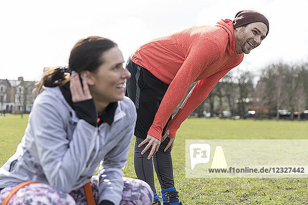 Man and woman exercising in park