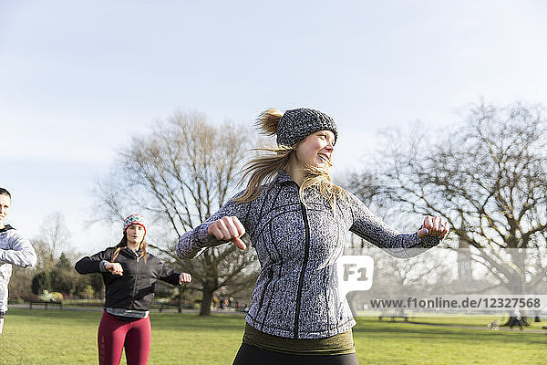 Woman exercising in sunny park