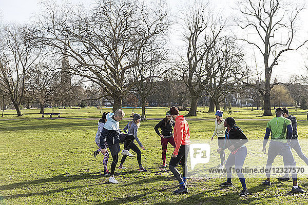 People exercising in sunny park