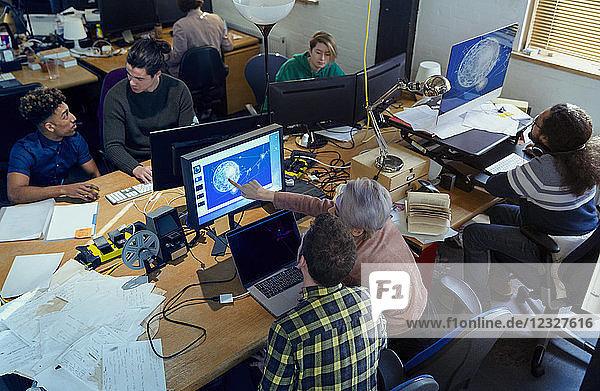 Creative designers working  meeting n open plan office