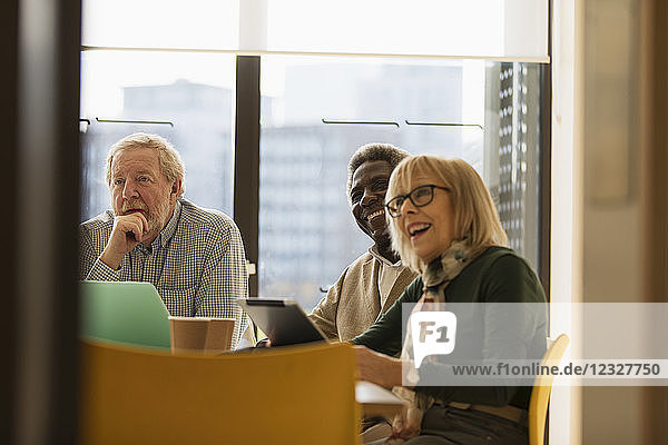 Smiling senior business people in conference room meeting
