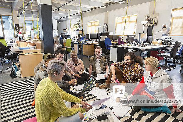 Creative business team meeting  brainstorming on floor in office