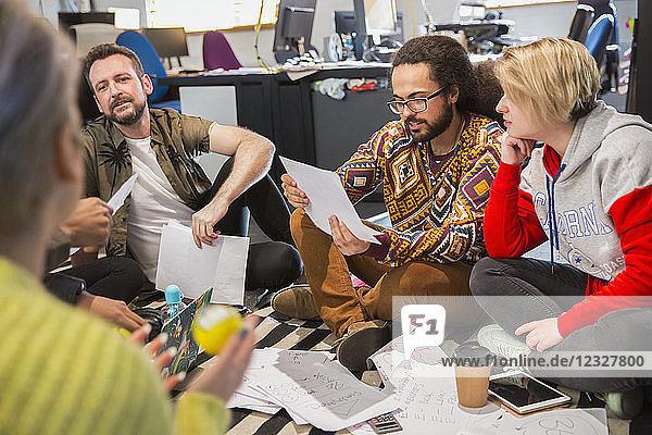 Creative business people meeting  reviewing paperwork