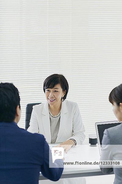Japanese senior businesswoman having meeting in the office