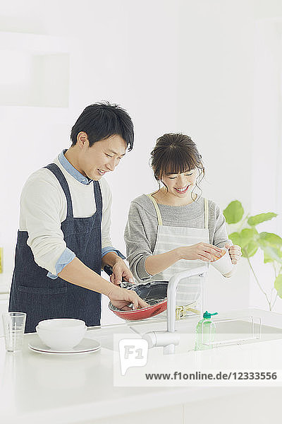 Japanese couple cooking in the kitchen