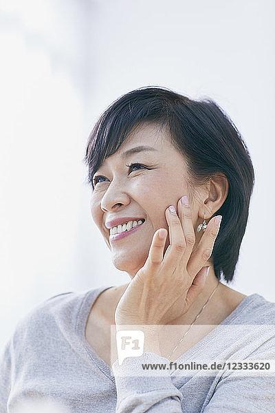 Japanese senior woman doing skin care