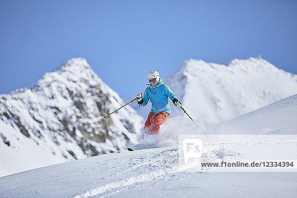 Austria  Tyrol  Kuehtai  woman skiing in winter landscape