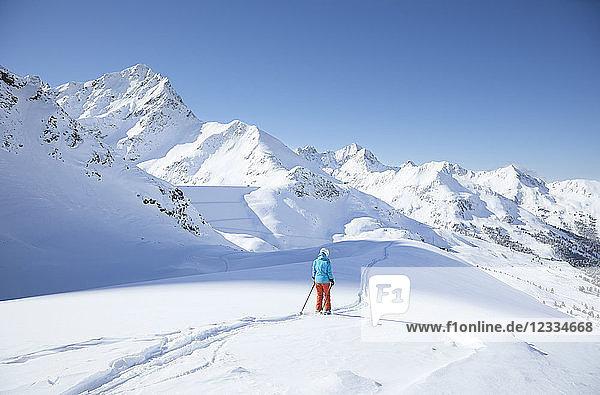 Austria  Tyrol  Kuehtai  female skier in winter landscape