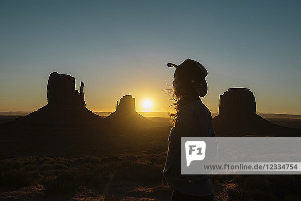 USA,  Utah,  Woman enjoying sunrise in Monument Valley